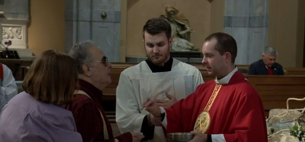 Fr. Jamie distributes Communion